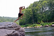 Boy Jumping off Rock